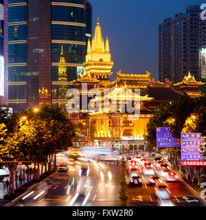 Jing'an Temple is a Buddhist temple on the West Nanjing Road in Shanghai, China. - Stock Photo