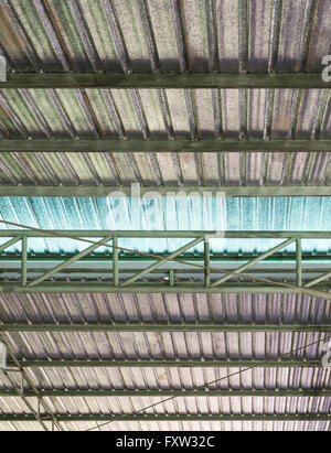 Metal sheet roof with insulation corrugated of the modern factory in Thailand. - Stock Photo