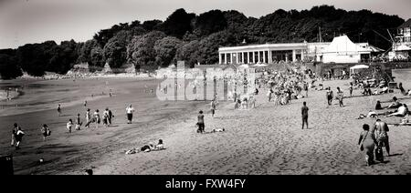 The seaside resort of Barry island South Wales UK. Taken during the summer months with bathers on the beach front. - Stock Photo