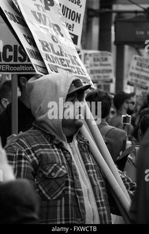 Picket Line- Not a strike- this anti-Trump demonstrator pauses with his signs to listen to a rally speaker - Stock Photo
