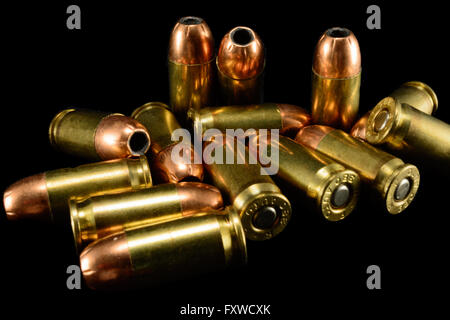 380 Auto bullets on black counter, black background, closeup - Stock Photo
