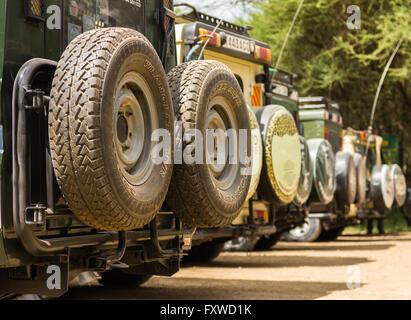 Safari vehicles parking at Main Entrance Gate, Tarangire National Park, Tanzania - Stock Photo