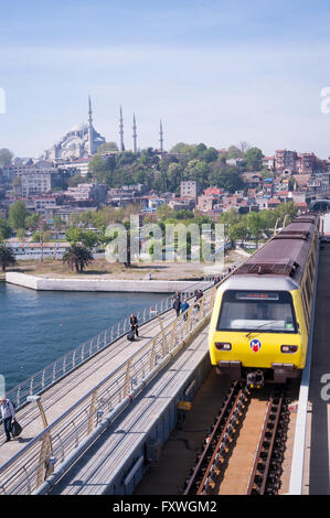 The new metro bridge took many years to construct and now crosses the Golden Horn in Istanbul - Stock Photo