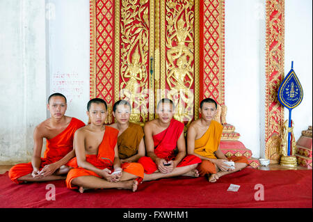 Asia. South-East Asia. Laos. Pakse. Young Buddhist monks at temple. - Stock Photo