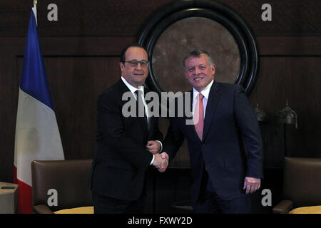 Amman, Jordan. 19th Apr, 2016. Jordanian King Abdullah II (R) shakes hands with French President Francois Hollande - Stock Photo