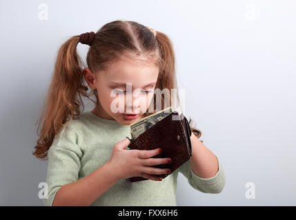 Cute surprising small kid girl looking in mother wallet and want to take money with empty copy space - Stock Photo