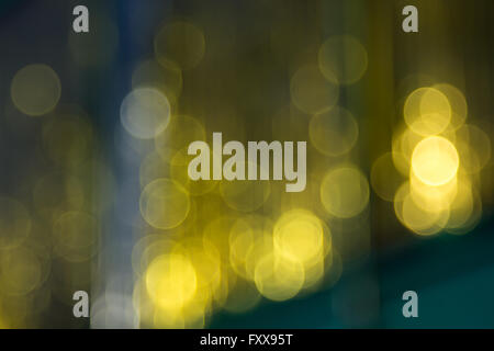 blurred golden lights in the green window - Stock Photo