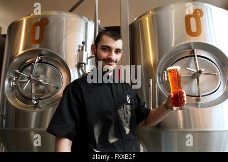 CARDIFF SOUTH WALES UK 17.MARCH 2016. Cardiff city center; Brew Pub Zero Degrees; master brewer Andrei Moisa holds - Stock Photo