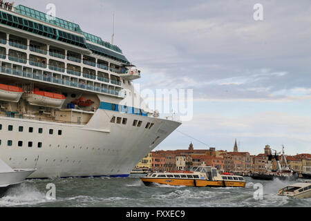 Cruise ship Splendour of the Seas, IMO 9070632, crowded marine traffic in Venice - Stock Photo