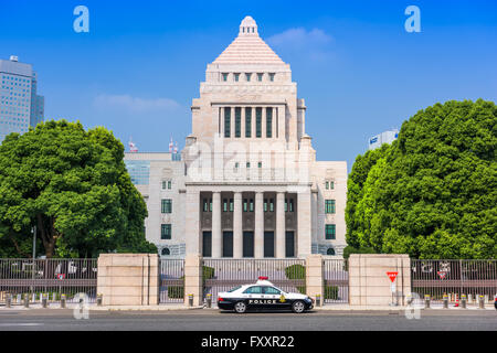 TOKYO, JAPAN - JULY 31 2015: A police crusier below The National Diet Building of Japan. - Stock Photo