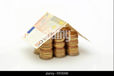 A house made of euro coins and a fifty euro note - Stock Photo