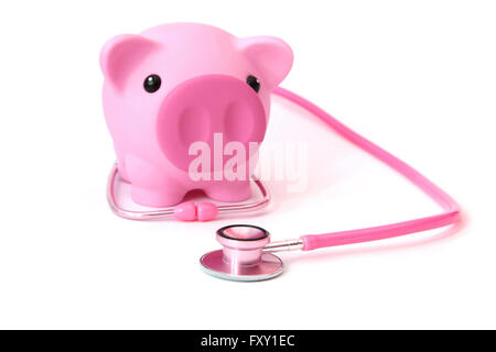 A piggy bank with a stethoscope - Stock Photo