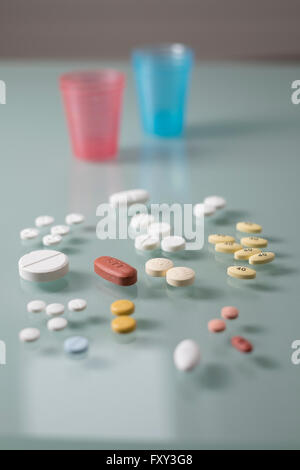 Pills and dispenser cups - Stock Photo