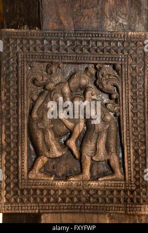 Sri Lanka, Kandy, Embekke Devale, digge pavilion, wrestling men carving on wooden pillar - Stock Photo