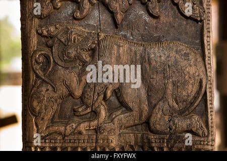 Sri Lanka, Kandy, Embekke Devale, digge pavilion, lion fighting elephant carving on wooden pillar - Stock Photo