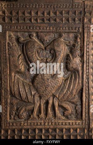 Sri Lanka, Kandy, Embekke Devale, digge pavilion, entwined peacocks carving on wooden pillar - Stock Photo