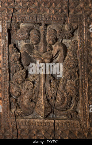 Sri Lanka, Kandy, Embekke Devale, digge pavilion, carved demonic face on wooden pillar - Stock Photo