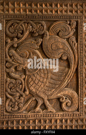 Sri Lanka, Kandy, Embekke Devale, digge pavilion, mythological, bird on wooden pillar - Stock Photo