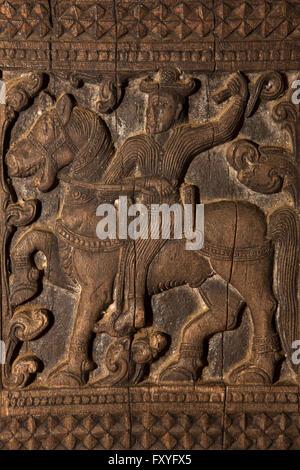 Sri Lanka, Kandy, Embekke Devale, digge pavilion, man on horseback carved on wooden pillar - Stock Photo