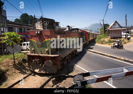 Sri Lanka, Kandy, train passing over level crossing - Stock Photo