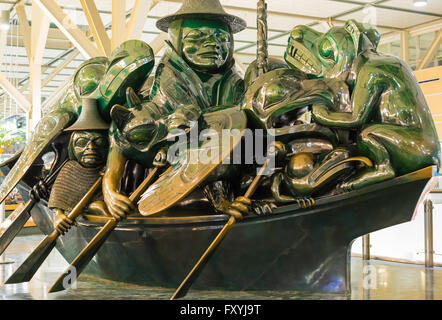 The Jade Canoe version of the Spirit of Haida Gwaii, by Bill Reid, located in the Vancouver International Airport. - Stock Photo