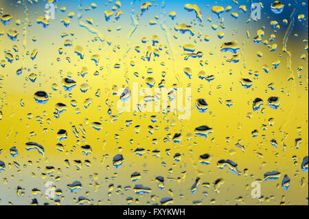 rain water droplets on wet motor car glass window - Stock Photo