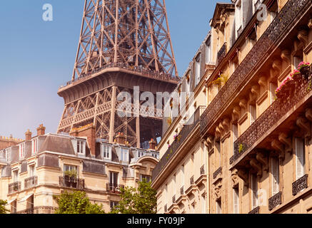 Eiffel Tower viewed from a nearby neighborhood. - Stock Photo