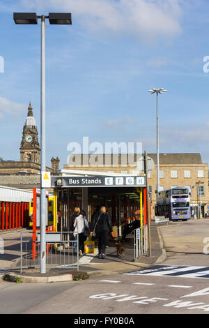 Passengers at Bolton Moor Lane bus station.  The station will close when a new public transport interchange opens - Stock Photo