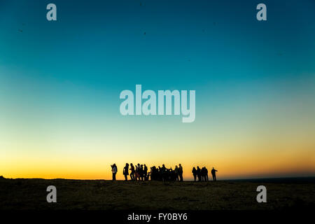 Large group of tourists watching and taking photos of famous sunset view over Saint Vicent cliifs, Portugal - Stock Photo