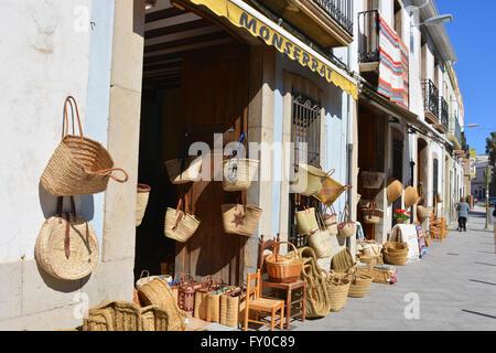 Baskets & rugs for sale, on display outside souvenir shops, Gata de Gorgos, Alicante, Valencia, Spain - Stock Photo