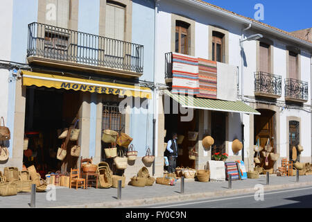 Well known street with baskets & rugs for sale, on display outside souvenir shops, Gata de Gorgos, Alicante, Valencia, - Stock Photo