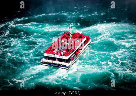 Hornblower boat at Niagara Falls Ontario and New York State - Stock Photo