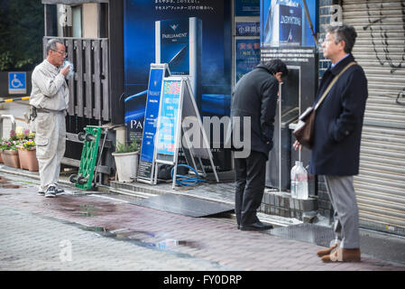 People on street in Akasaka district, Minato special ward, Tokyo city, Japan - Stock Photo