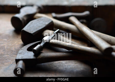 Pile of vintage hammers in shed - Stock Photo
