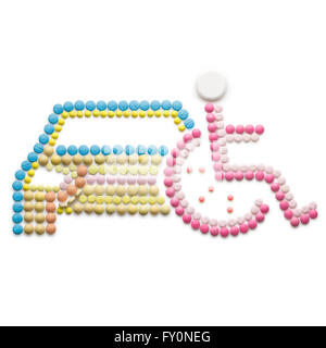 Creative medicine and healthcare concept made of drugs and pills, isolated on white. Abstract wheelchair invalid - Stock Photo