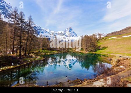 Matterhorn reflected in Blue Lake - Stock Photo