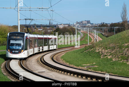 Edinburgh tram on route from Edinburgh airport  to the city centre with Edinburgh castle in the distance. - Stock Photo