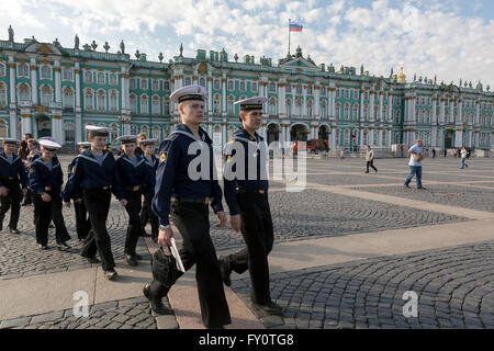 Boys clothing sailors walking on the Palace Square at the center of St. Petersburg city, Russia - Stock Photo