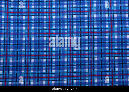 Closeup of colorful square patterns and textures on blue fabric background - Stock Photo