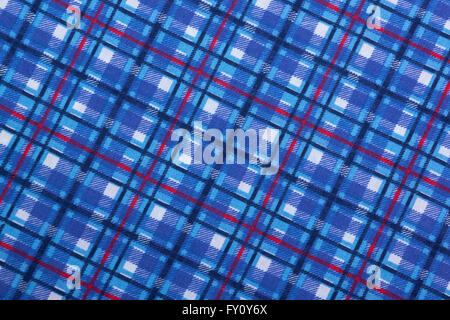 Closeup angled view of colorful blue square patterns and textures on blue fabric background - Stock Photo