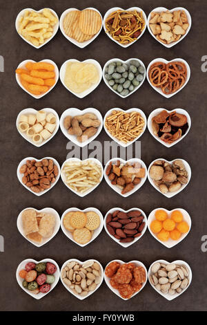Savory snack party food selection in heart shaped porcelain bowls. - Stock Photo