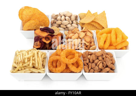 Savoury snack party food selection in square porcelain bowls over white background. - Stock Photo