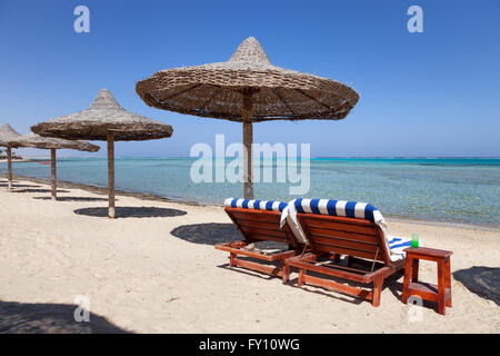 Marsa Alam beach with the two beach beds and umbrella, Egypt - Stock Photo