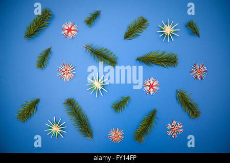 Directly above shot of Christmas decorations on blue background - Stock Photo