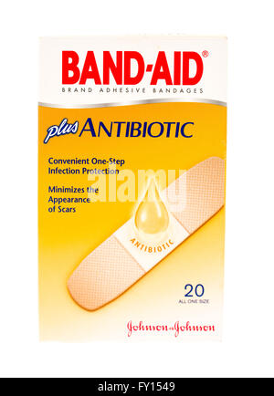 Winneconne, WI - 20 April 2015:  Box of Band-Aid plus anibiotics to help in minimizing the appereance of scars. - Stock Photo