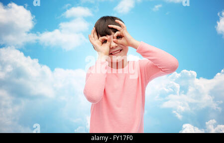 happy little girl making faces and having fun - Stock Photo