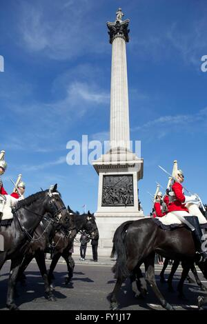 London, United Kingdom. 20 April 2016. The Household Cavalry pass through Trafalgar Square whilst exercising their - Stock Photo