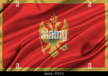 Flag of Montenegro waving in the wind. - Stock Photo