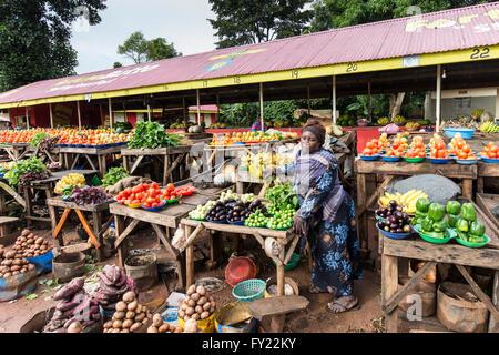 A woman selling vegetables on a street market, Kampala, Uganda - Stock Photo