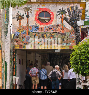 Square view of people looking at the colourful mosaics at Fusterlandia in Havana, Cuba. - Stock Photo